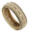 This handsome antique wedding band is crafted of 8K yellow gold and adorned with layers of etched lines