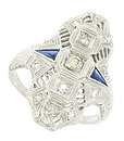 This spectacular 18K white gold engagement ring features a trio of fine faceted diamonds that drape down the rings face