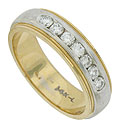 This handsome mens wedding band is crafted of 14K white and yellow gold