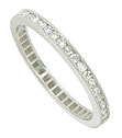 This sparkling platinum estate wedding band is bezel set with a string of fine faceted diamonds