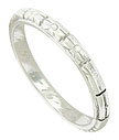 This handsome antique wedding band is fashioned of 18K white gold and decorated with abstract floral engraving