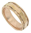 This unusual antique wedding band features softened corners and abstract engraving
