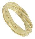 Bold waves of yellow gold twirl across the surface of this handsome estate wedding band