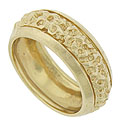 This handsome mens wedding band features abstract engraving and wide curving outer bands