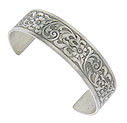 Intricate engraved flowers and curling foliage dance across the surface of this spectacular sterling silver bangle