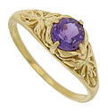 The sparkling shoulders of this 14K yellow gold ring are decorated with bold abstract floral cutwork