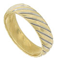 This handsome 14K yellow gold estate wedding band is decorated with a pattern of diagonal lines sliced into the surface