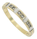 Three pair of sparkling fine faceted diamonds are set into the face of this 14K yellow gold wedding band