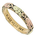 This spectacular 14K tri-color wedding band is a truly lovely example of Black Hills gold