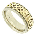 A wide carved braid is pressed into the deep center channel of this 14K bi-color wedding band