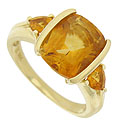 This spectacular estate ring features a bold 14K yellow gold mounting set with warm, honey hued Madiera Topaz