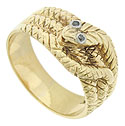 An intricately engraved twisting snake curls across the surface of this unique 14K yellow gold estate ring