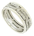 Twisting floral engraved braids adorn the face of this 14K white gold vintage wedding band