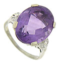 A fantastic oval cut amethyst is the star of this 14K white gold estate ring