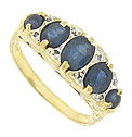 Deep blue sapphires press into the surface of this lovely 14K yellow gold estate ring