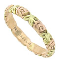 Intricately engraved roses and leaves adorn the surface of this 14K rose and green gold wedding band