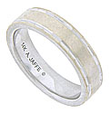 This handsome 14K white gold estate wedding band is adorned with simple slim channels