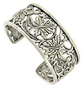 Fantastic cutwork of curling vines and leaves twist across the surface of this antique style bracelet