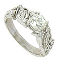 A brilliant EGL certified, .95 carat, H color, Si2 clarity diamond glows from the face of this antique style engagement ring