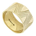 This stunning 14K yellow gold estate wedding band is engraved with a undulating trio of curling figures