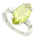 A sparkling marquis shaped lemon quartz crystal is set into the face of this sterling silver ring