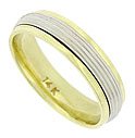 This elegant 14K bi-color wedding band features a wide white gold ribbon impressed with rows of impressed milgrain design