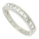 A row of ten dazzling square cut diamonds are bezel set into the face of this elegant estate wedding band