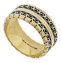 Lacy, scalloped figures adorn the surface and edges of this elegant 14K yellow gold wedding band