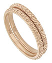 Abstract floral engraving and impressed milgrain adorn the surface of these 14K rose gold stackable wedding bands