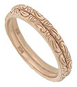 A lovely abstract floral engraving dances across the surface of these antique style stackable wedding bands
