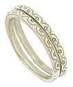 Abstract lace engraving presses into the surface of these elegant 14K white gold wedding bands