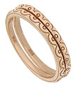Scalloped and circular engraving adorn the face of these lovely antique style wedding bands
