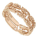 Strings of spring flowers sprout from the surface of these 14K rose gold wedding bands