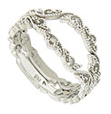 Milgrain frosted flowers and vines dance across the surface of these 14K white gold wedding bands