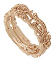 Sparkling vines and flowers curl across the surface of these 14K rose gold wedding bands