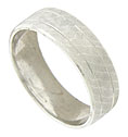 This handsome, wide mens wedding band features a pair of deeply engraved channels that encircle the wedding ring