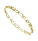 Twirling 14K yellow gold vines sprout with fine faceted diamonds on the surface of this antique style bangle bracelet