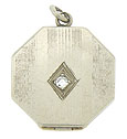 This elegant Art Deco locket is fashioned of 14K white gold and octagonal in shape