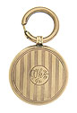 This elegant 14K yellow gold watch fob is engraved with elegant ribbons and a simple circle in the center features a monogrammed engraving LHK Jr