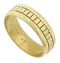 A simple engraved block pattern encircles the face of this 14K yellow gold estate wedding band