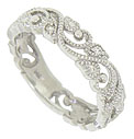 Delicate blooming vines wind around the face of this 14K white gold floral wedding band