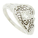 Elegant abstract floral cutwork and engraving adorns the face of this antique style wedding band