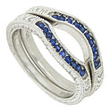 Deep blue sapphires are set into the curve of these 14K white gold wedding bands