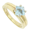 A dazzling .85 carat, kite cut aquamarine floats above the surface of this 14K yellow gold estate ring
