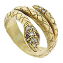This amazing 14K yellow gold estate ring is fashioned in the image of a snake