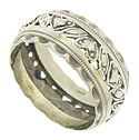 This antique wedding band features layers of decoration