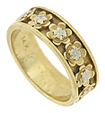 Perky blossoms dance across the surface of this estate wedding band