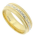 This handsome wedding band is crafted of 14K yellow gold and decorated with jewel cut engraving