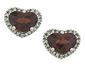 These romantic antique style earrings feature heart shaped garnets framed in fine faceted diamonds