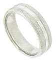 Wide hewn facets adorn the edges of this 14K white gold mens wedding band